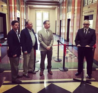 Fresno County Auditor-Controller/Treasurer-Tax Collector, Oscar Garcia, speaks at the ribbon cutting event alongside County Supervisors (L to R) Brian Pacheco, Buddy Mendes, and Nathan Magsig.